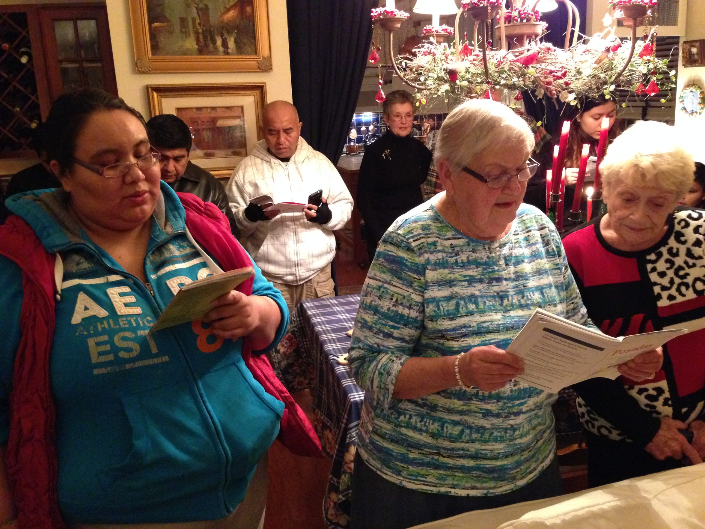 Laura Campos, left, of Jackson, sings during the Las Posadas ceremony on Dec. 17, 2015 beside Irene Slamka (center) and Connie Beckman, both of Brick.