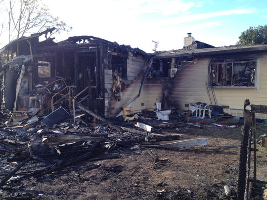 The fire originated in the home's garage and spread to the house.