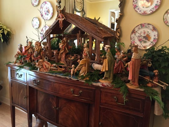 A 25-piece nativity scene covers the sideboard in the Well's dining room for the holidays.
