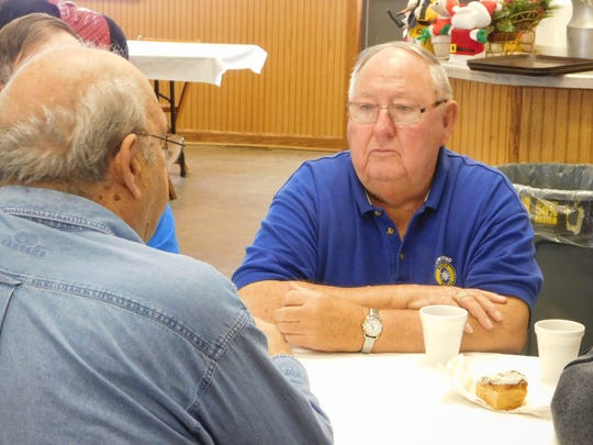 Rod Perry, secretary of the Townsend Ruritan, talks to a friend during the December Ruritan community pancake breakfast in Vickery.
