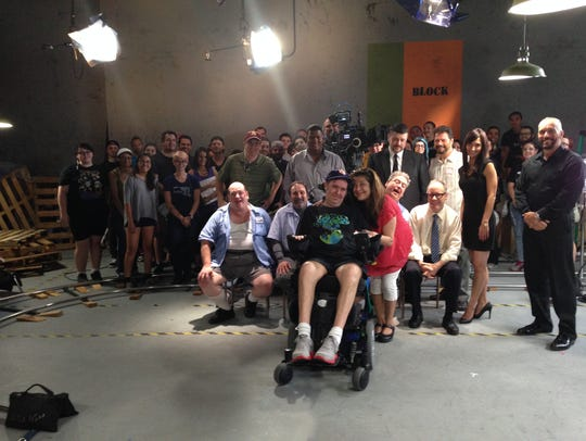 Ron Hunting, at center, poses with the crew and cast