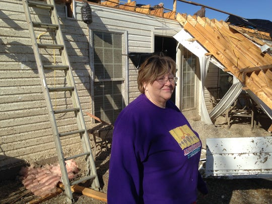 Nancy Maness stands in the backyard of her home on Dickenson Road.