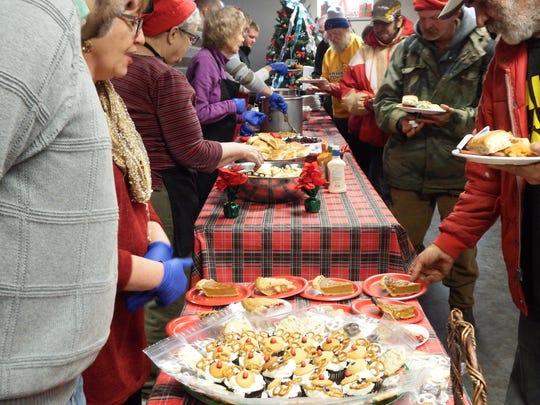 Food is served up at the Free Lunch Program's Christmas Day lunch in Iowa City on Friday, Dec, 25, 2015.