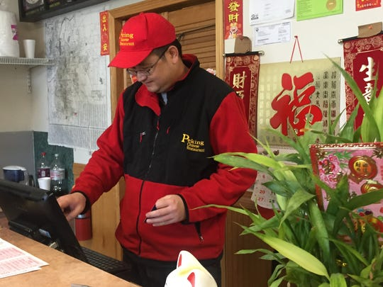 Peking Chinese Restaurant owner Wei Huang writes up another Christmas Day order to go.