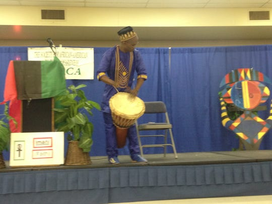 Saikou Kamateh plays a West African drum during the 27th annual Kwanzaa celebration at T.R. White Sportsplex.