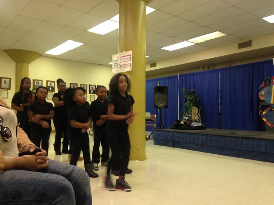 "Students from Lincoln Elementary School's LEAP program perform ""Funga Alafia"" during Sunday's Kwanzaa celebration."