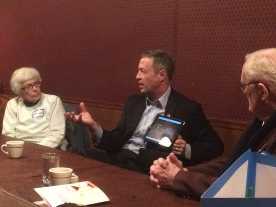 Martin O'Malley talks about management styles to a crowd of five on Monday in Webster City.