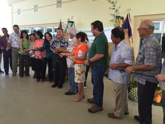 Island leaders, farmers and family of the late Sen. Ben Pangelinan cut the ribbon for the Speaker Vicente (Ben) Pangelinan Guam Farmers Market:Sagan Lina'la I Manaotao Tåno on Dec. 29.