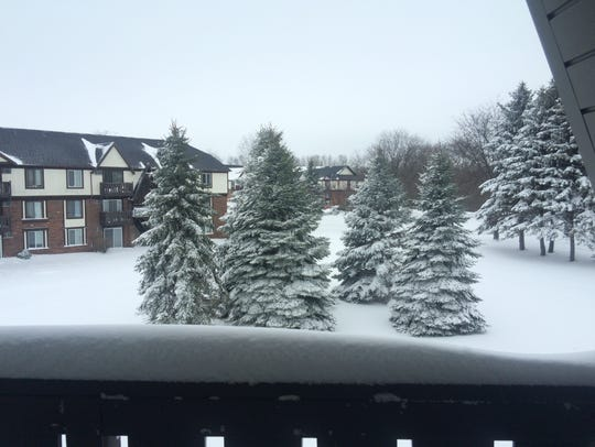 View of snow from an apartment complex in Ashwaubenon.