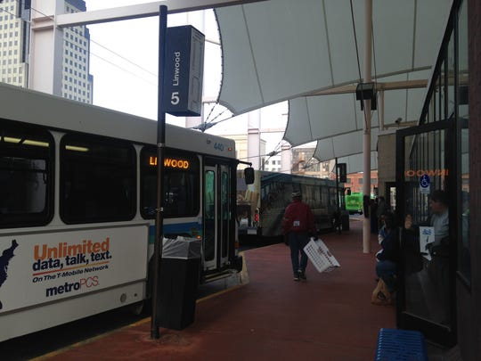 Riders wait for their bus at SporTran's downtown terminal.