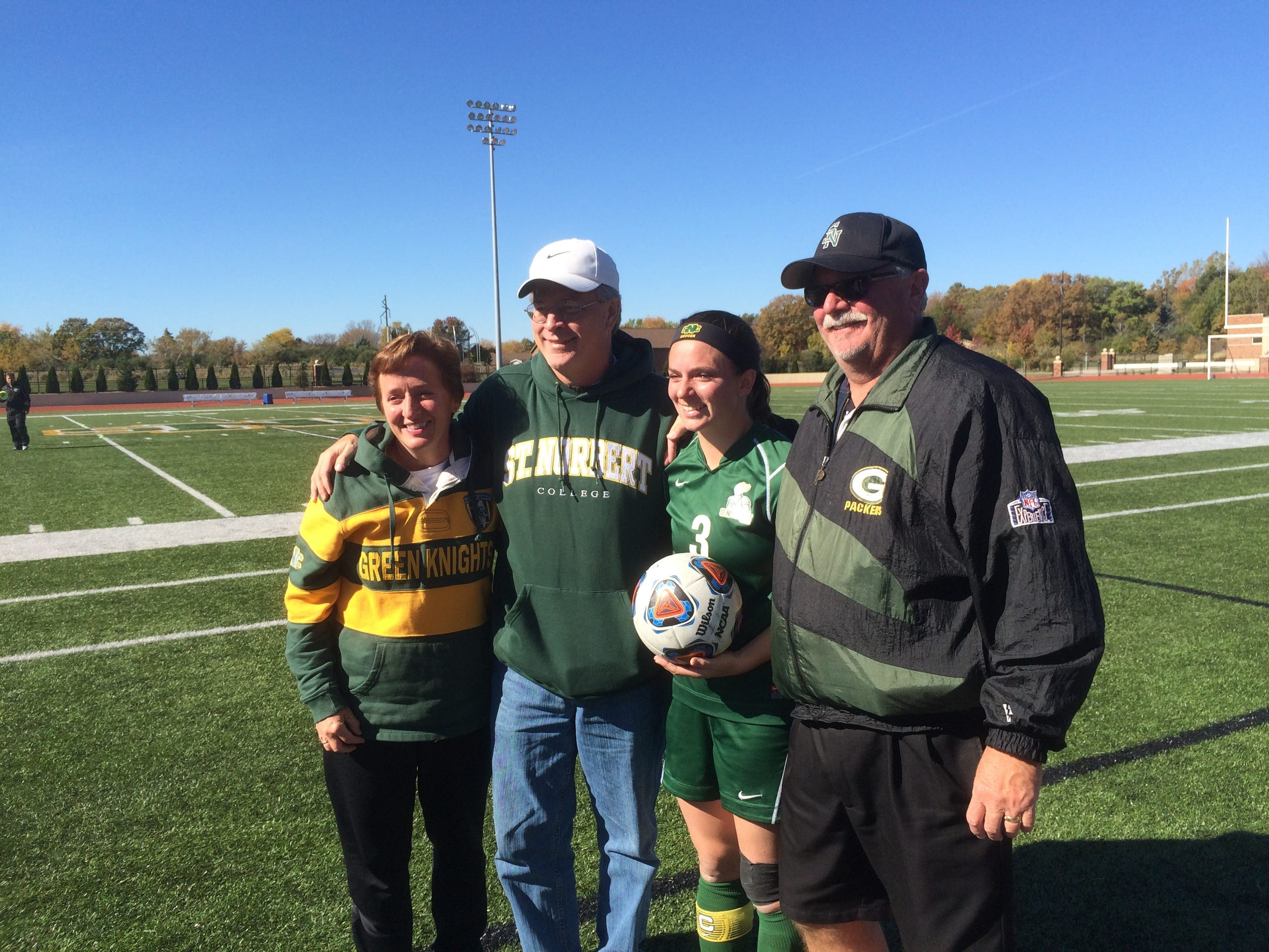 St. Norbert College senior Katie Vanden Avond receives the game ball after tying the NCAA Division III career goals record.