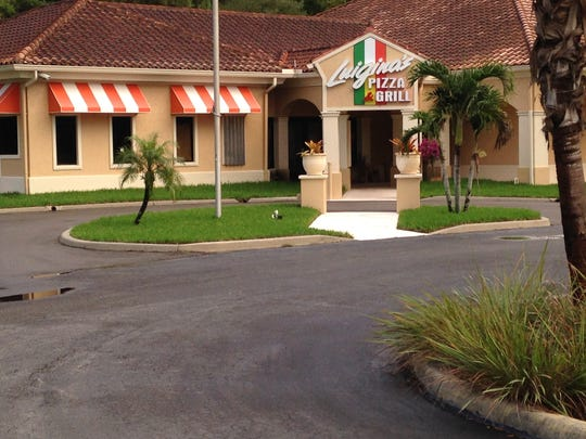 Signs are up for Luigina's Pizza & Grill in San Carlos Park.