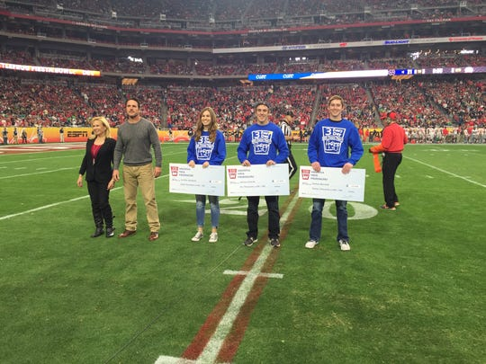 Left to right: Arizona Milk Producers GM Tammy Baker, Arizona Milk Producers Board Chairman Craig Caballero, 3rd Place Winner Jenny Butzbach, 2nd Place Winner Johnny Schmidt, and 1st Place Winner Corona's Nate Marshall at the Fiesta Bowl on Jan. 1.