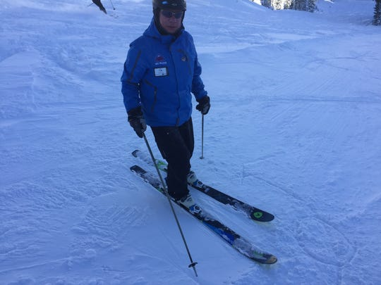Instructor Tom Haley explains a proper turn during a 2015 ski lesson at Mt. Rose Ski Tahoe.