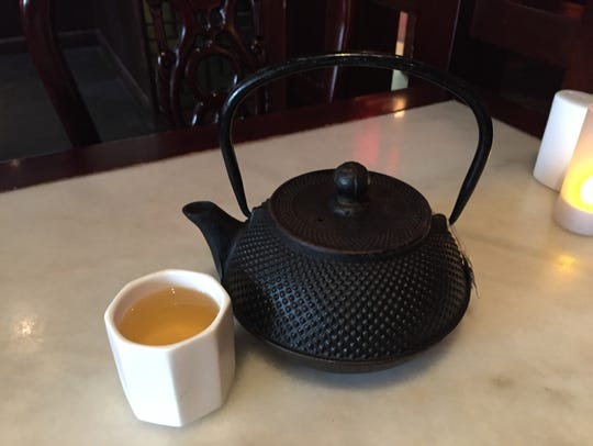 Green tea served in a traditional pot.