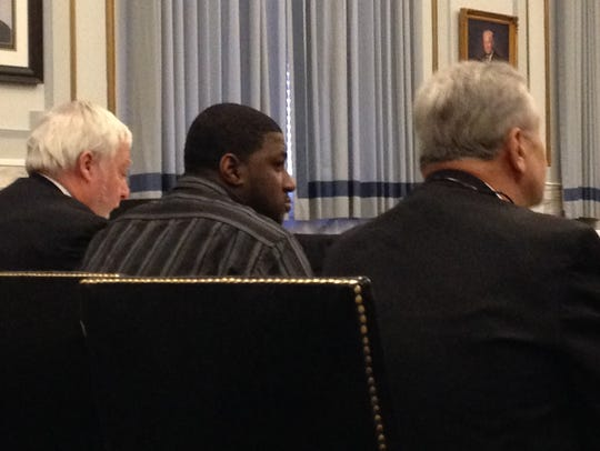 Hamm sits between his attorneys in Hamilton County