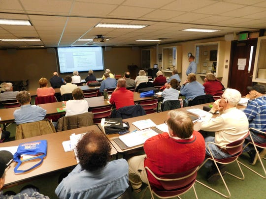 Volunteers sit through a morning tax class at Birchard Public Library on Jan. 5. They will be assisting senior citizens and low income families in filing 2015 tax forms.