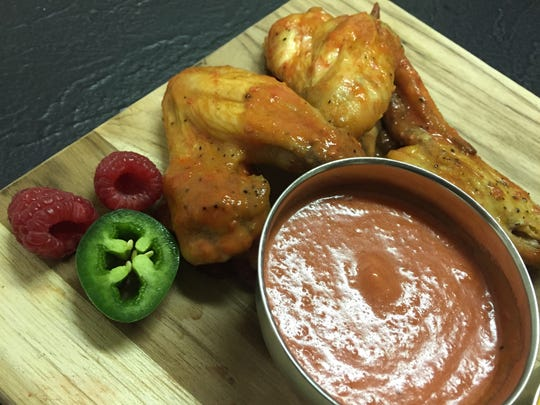 Chicken wings in a raspberry jalapeno sauce.