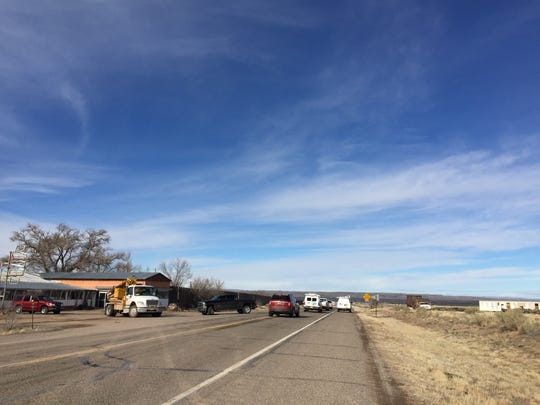 Police and emergency vehicles block Highway 380 at