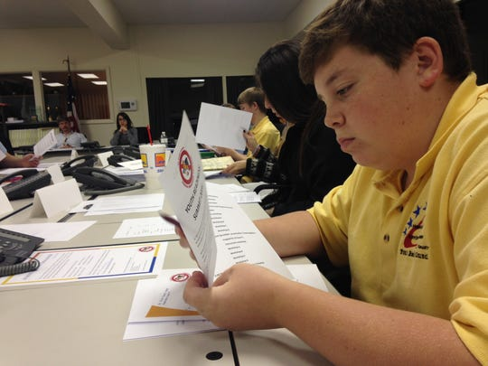 Algonac High School freshman Timothy Merlo, 15, reviews material during a Youth Readiness Council meeting Wednesday evening at the office of Homeland Security Emergency Management in Kimball.