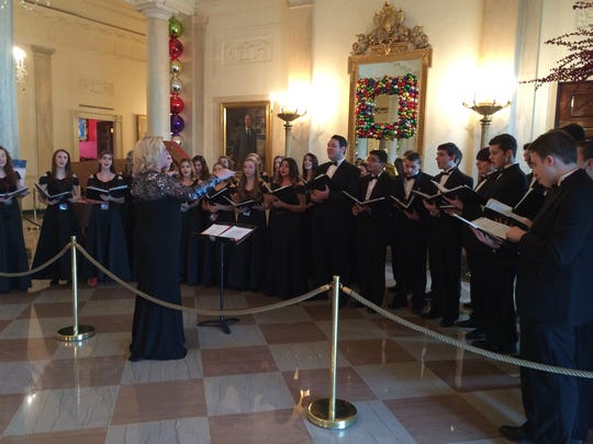 Nicole Snodgrass (center) directs the Cherokee High School Concert Choir at a performance at the White House last month.