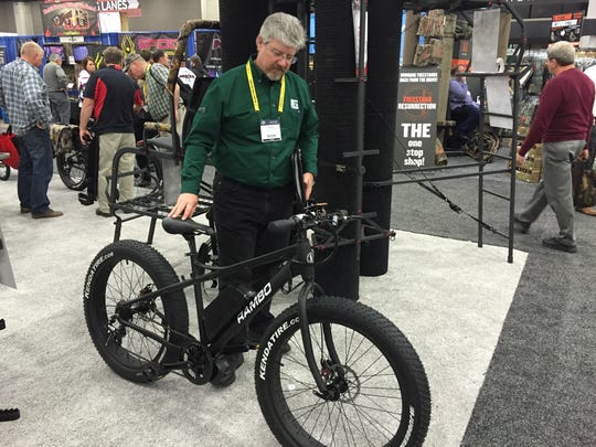 Alan Clemons, online editor for Deer & Deer Hunting magazine, inspects the 2016 Rambo bike, one of the thousands of items at the Archery Trade Association annual trade show, which was held last week at the Expo Center.