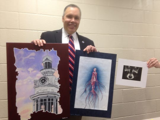 State Rep. Bryan Terry, R-Murfreesboro, holds two of