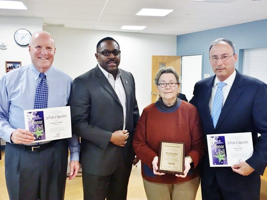 Lin Carpenter (second from left), assistant executive director of the Pennsylvania School Board, presents service recognition certificates to school directors Tom Schafer, Rose Marie Kotay and Peter Pyles. Not shown are Debra Bowman and former director Anne Dall.