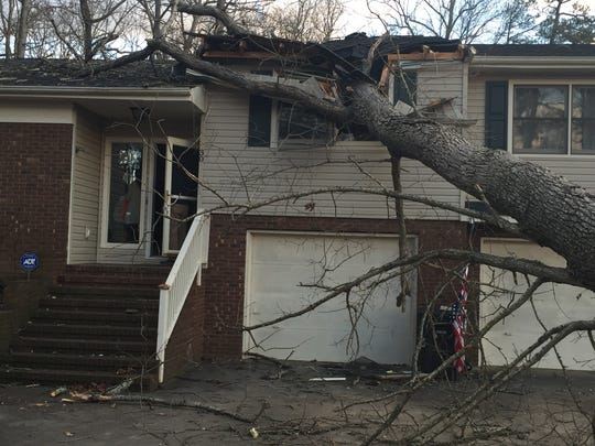 A tree fell on this home on Tall Oaks Road Tuesday afternoon in Candler amid high winds. The Enka-Candler Fire Department told the residents it was not safe to occupy.