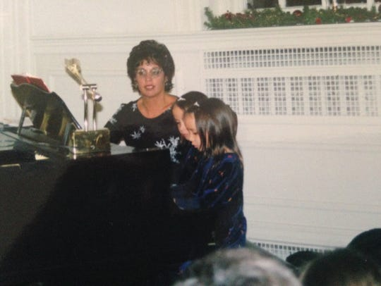 Nalani & Sarina in a piano recital at a young age.