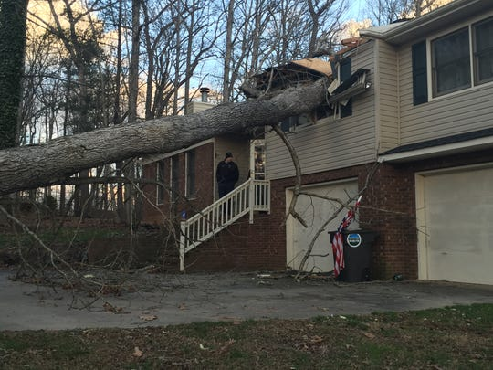 Winds toppled a large tree into a home on Tall Oaks Road in Candler on Tuesday.