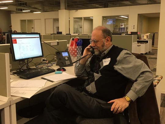 Volunteer Paul L. Takes a call on the new IndyStar Call for Action consumer hotline.