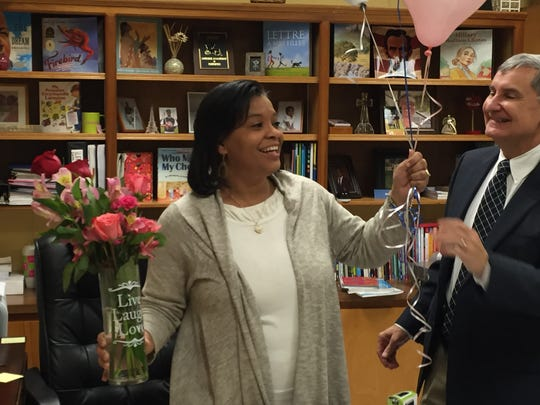 Felise Williams, the principal of Evangeline Elementary, reacts to being named the Lafayette Parish elementary principal of the year. Also pictured is Lafayette Parish Superintendent Donald Aguillard.