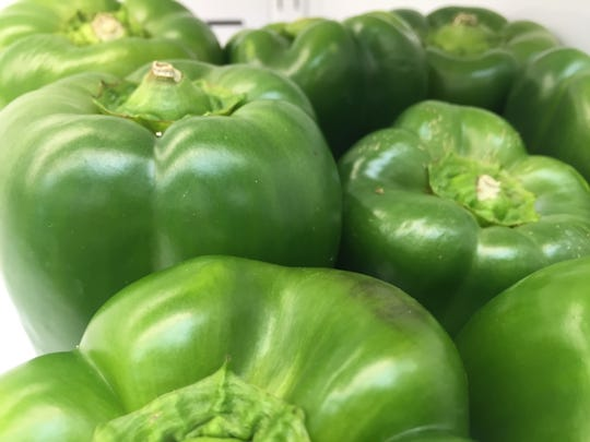 Green bell peppers inside the deli grocery on North Allen Ave