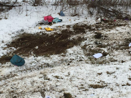 Debris from a one-vehicle crash Friday at Ohio 13 and Vanderbilt Road littered a ditch.
