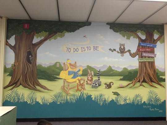 Pam Mason and Kathy Denk painted this mural inside the Showell Elementary School library.