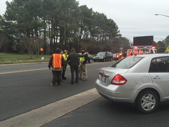 Officials talk outside Parkside High School after a