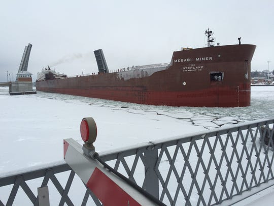 The Mesabi Miner passes through Sturgeon Bay's Maple-Oregon Bridge on its way to winter maintenance at Bay Shipbuilding Co. A U.S. Coast Guard ice breaker was on Green Bay this week keeping shipping lanes open for the last ships of the season.