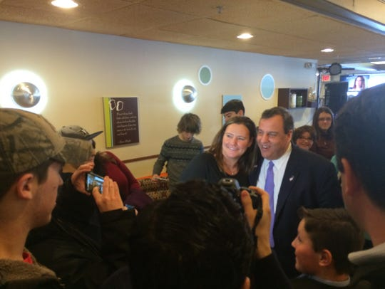 Chris Christie poses for photos with supporters Monday,