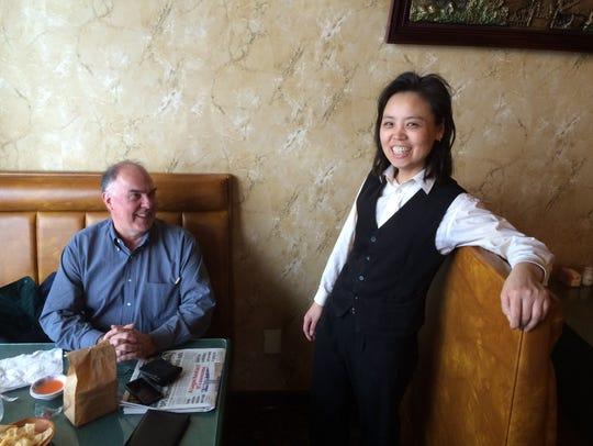 Gourmet Garden co-owner Yongmei Huang visits with customer