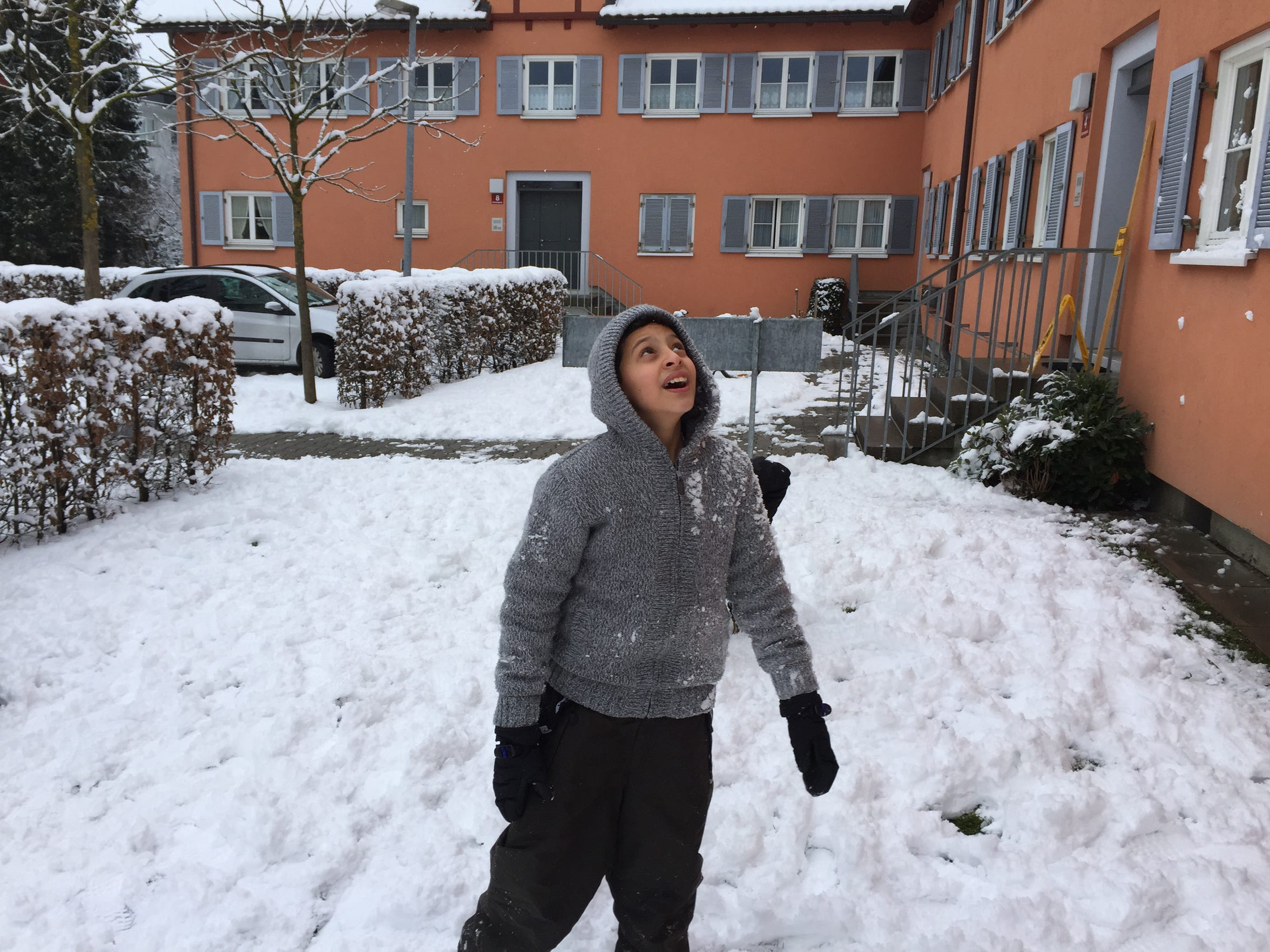 Mohamad Helani joins in a snowball fight outside his