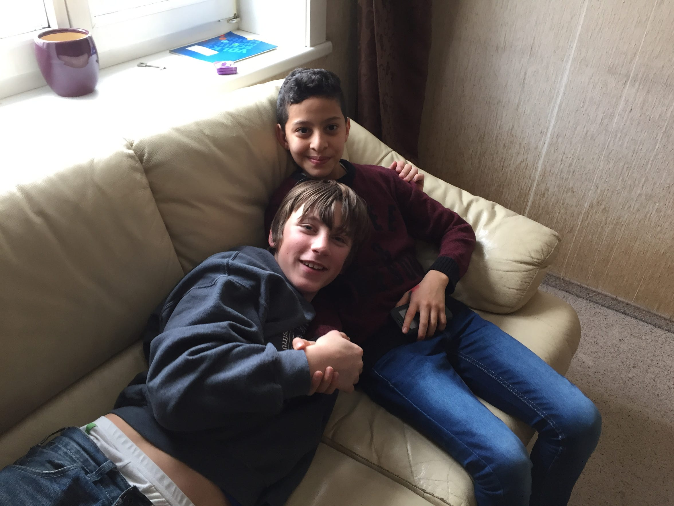 Sasha Griesser, 13, left, and his new friend Mohamad