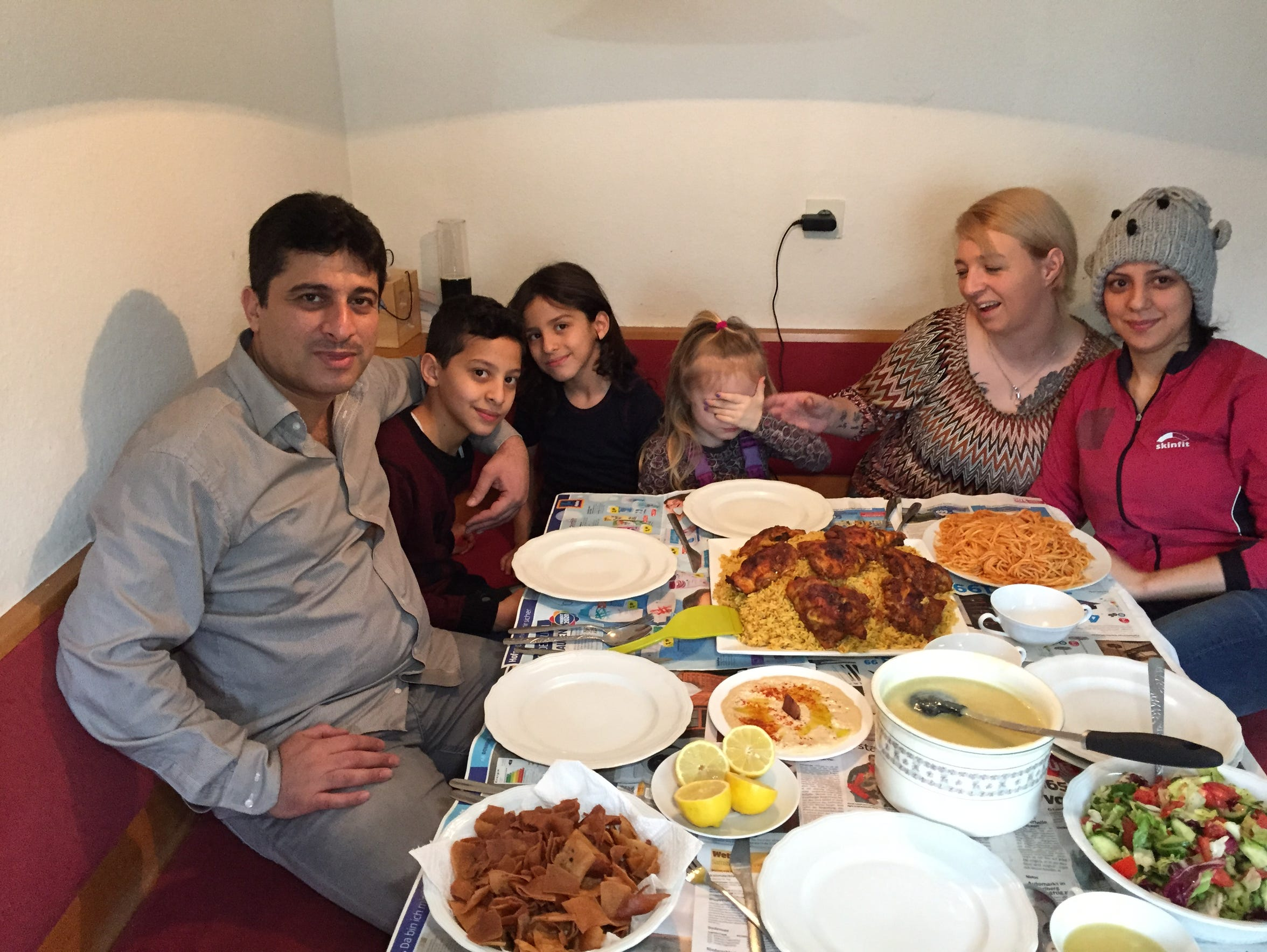 The Helani family serves lunch to their friends. From