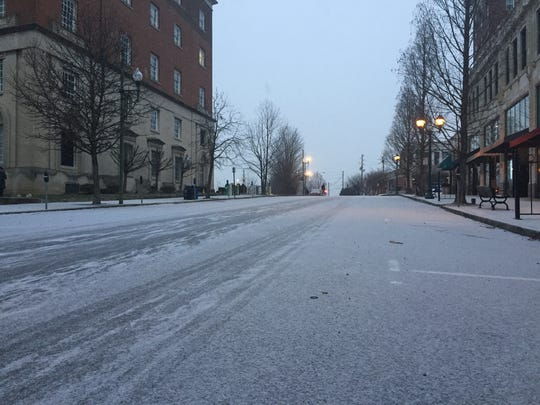 Snow was falling in downtown Asheville around 8 a.m.