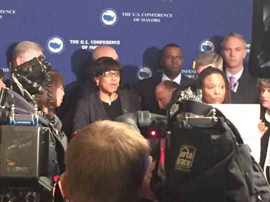 Flint Mayor Karen Weaver, center, speaks at the U.S. Conference of Mayors meeting in Washington.