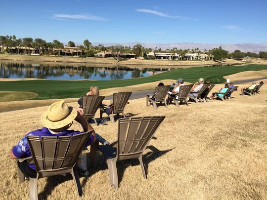 Golf fans watch from the comfort of new Adirondack chairs during the CareerBuilder Challenge at TPC Stadium course at PGA West on Jan. 20, 2016.