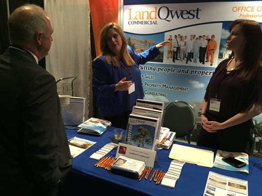 LandQwest Commercial marketing staff Courtney Saksefski (middle) and  Heather Heinzeroth (right) talk shop at CCIM's 2016 Commercial Real Estate Outlook Conference on Thursday in Fort Myers.