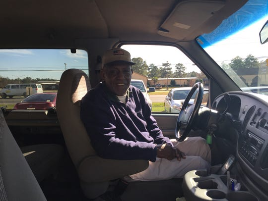 Jerry Fields waits outside in the carpool line to pick