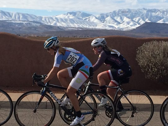 Cyclists competing in the women's Cat 3 and 4 race in the Desert City Crit Series hosted by Rapid Cycling Races finish another lap around the course in St. George Saturday, Jan. 9, 2016.