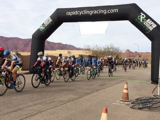 The men's Cat 3 and 4 cyclists finish another lap during  the first race of the Desert City Crit Series hosted by Rapid Cycling Races Saturday, Jan. 9, 2016.